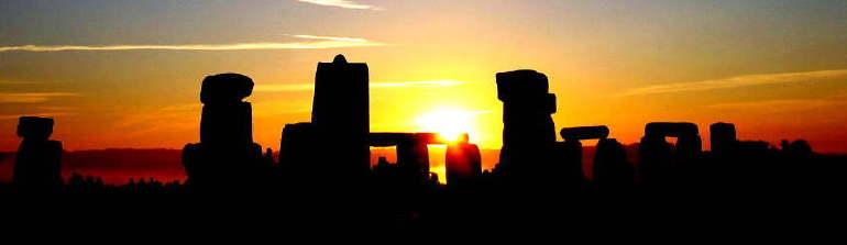 photo of sunrise over Stonehenge